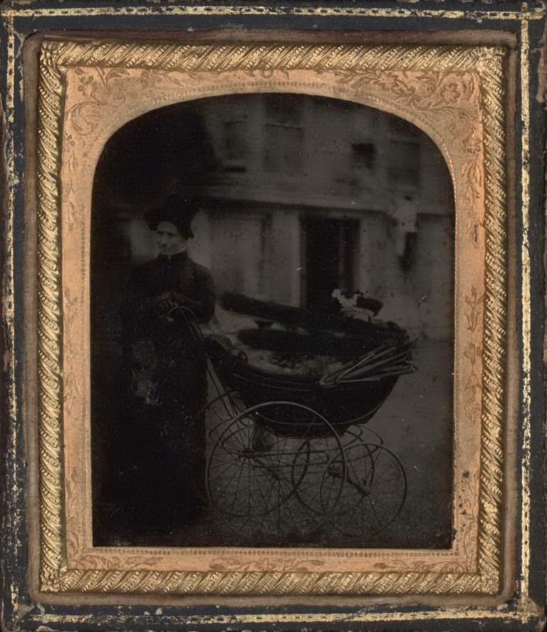 [Woman With Infant In Perambulator]