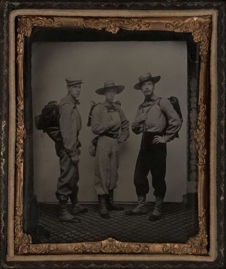 [Portrait Of Three Miners]