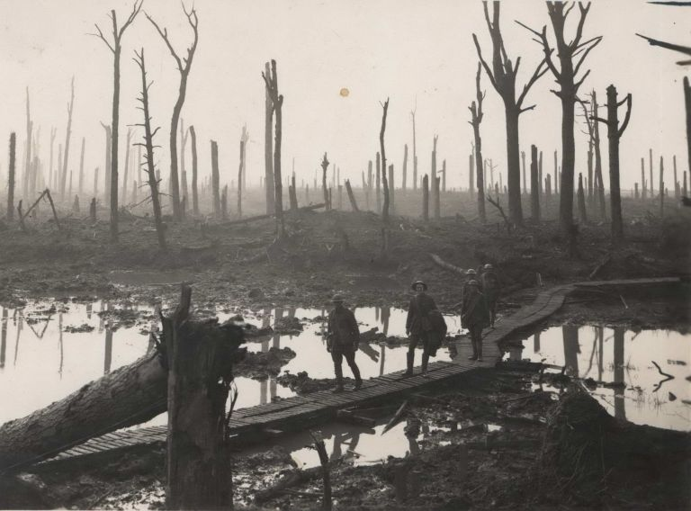 Australians Passing Along A Duck-Board Track, Chateau Wood, Ypres Salient In Belgium. Frank Hurley, Australian.
