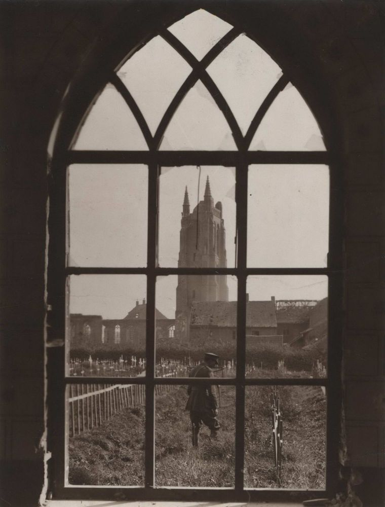 [Looking Through A Ruined Cathedral Window Onto A Battlefield Cemetery]. Frank Hurley, Aust.