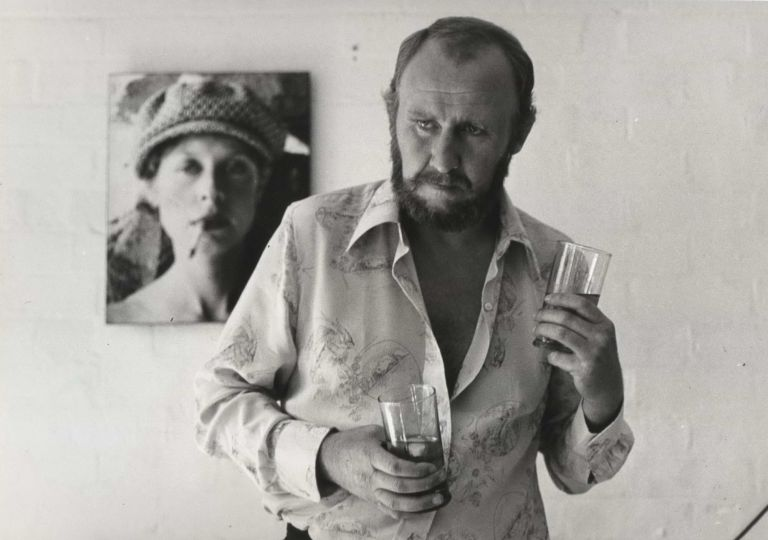 "[Bill Hunter With Photograph Of Judy Morris In Background On The Set Of ""In Search Of Anna""]. Carol Jerrems, Aust."