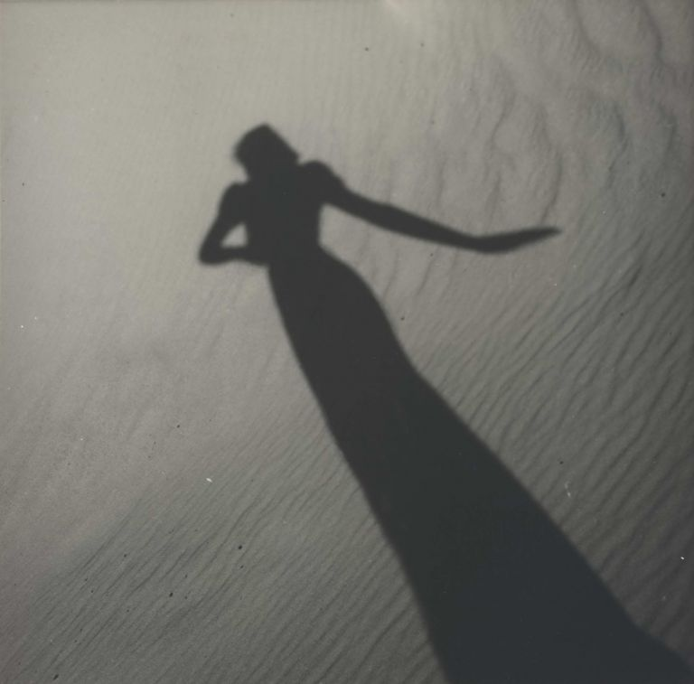 [Model's Shadow On Sand]. Olive Cotton, Australian.