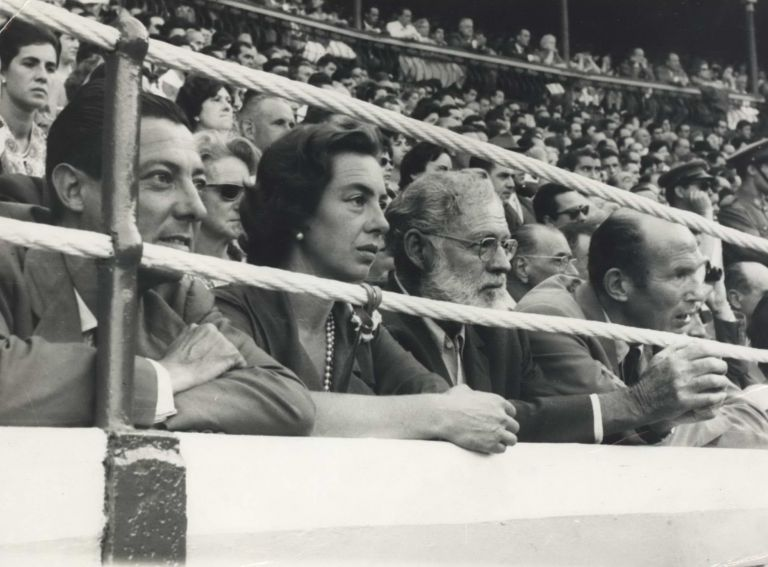 [Ernest Hemingway In The Front Row At A Bullfight]. Cuevas, fl. 1950s- 1960s Spanish.