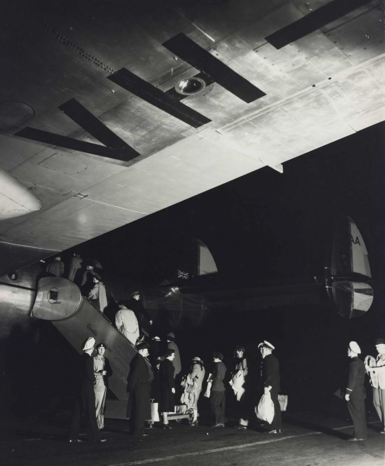 [Passengers Boarding A Qantas Constellation Plane At Night]. Max Dupain, 1911–1992 Aust.