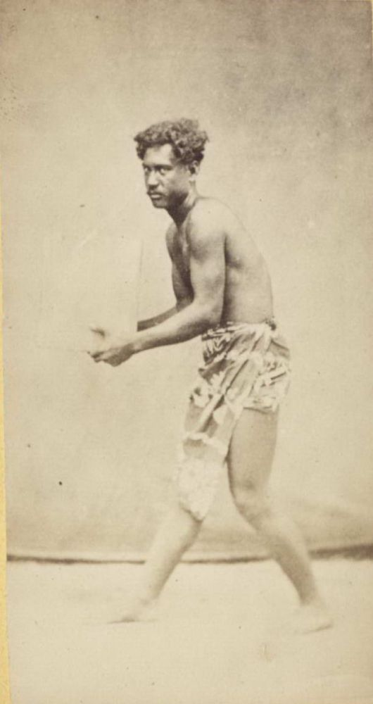 [Polynesian Man Holding An Object, Possibly A Block Of Ice]