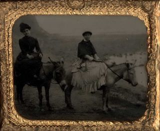Two Women Riding Donkeys