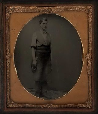 Full Length Portrait Of A Young Blacksmith