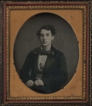 [Portrait Of A Young Man With Large Bow Tie, USA]. E T. Whitney, American.