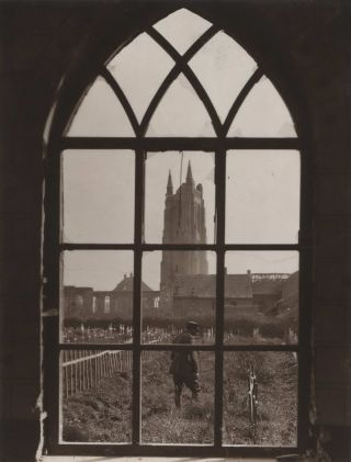 Looking Through A Ruined Cathedral Window Onto A Battlefield Cemetery]. Frank Hurley, Aust