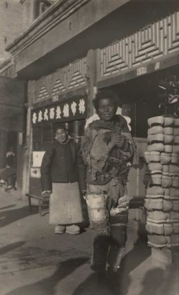 Street Scene With Man Dressed In Rags]. Boxiang Hu, Chinese