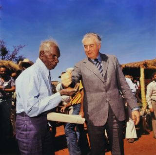 Prime Minister Gough Whitlam Pours Soil Into Hand Of Traditional Land Owner (Gurindji) Vincent...