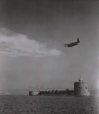 Sea Plane Flying Over Fort Denison, Sydney Harbour]. Max Dupain, Australian