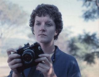 "Carol Jerrems With Olympus Camera On The Set Of ""In Search Of Anna""]. Attrib. Esben..."