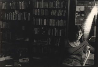 Anne Summers [Seated Near Bookcase]. Carol Jerrems, Aust