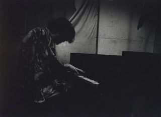 "Bass Player ""Jimmy"" Stevenson At Piano, ""Jazz Loft"", New York]. W. Eugene Smith, Amer"