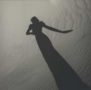 Model's Shadow On Sand]. Olive Cotton, Australian